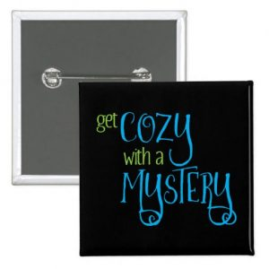 Get Cozy with a Mystery Button (colored design on dark)