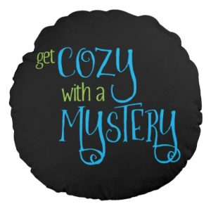 Get Cozy with a Mystery Round Pillow (colored design on dark)