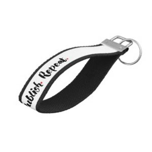 Write. Edit. Publish. Repeat. Wrist Keychain (white design)
